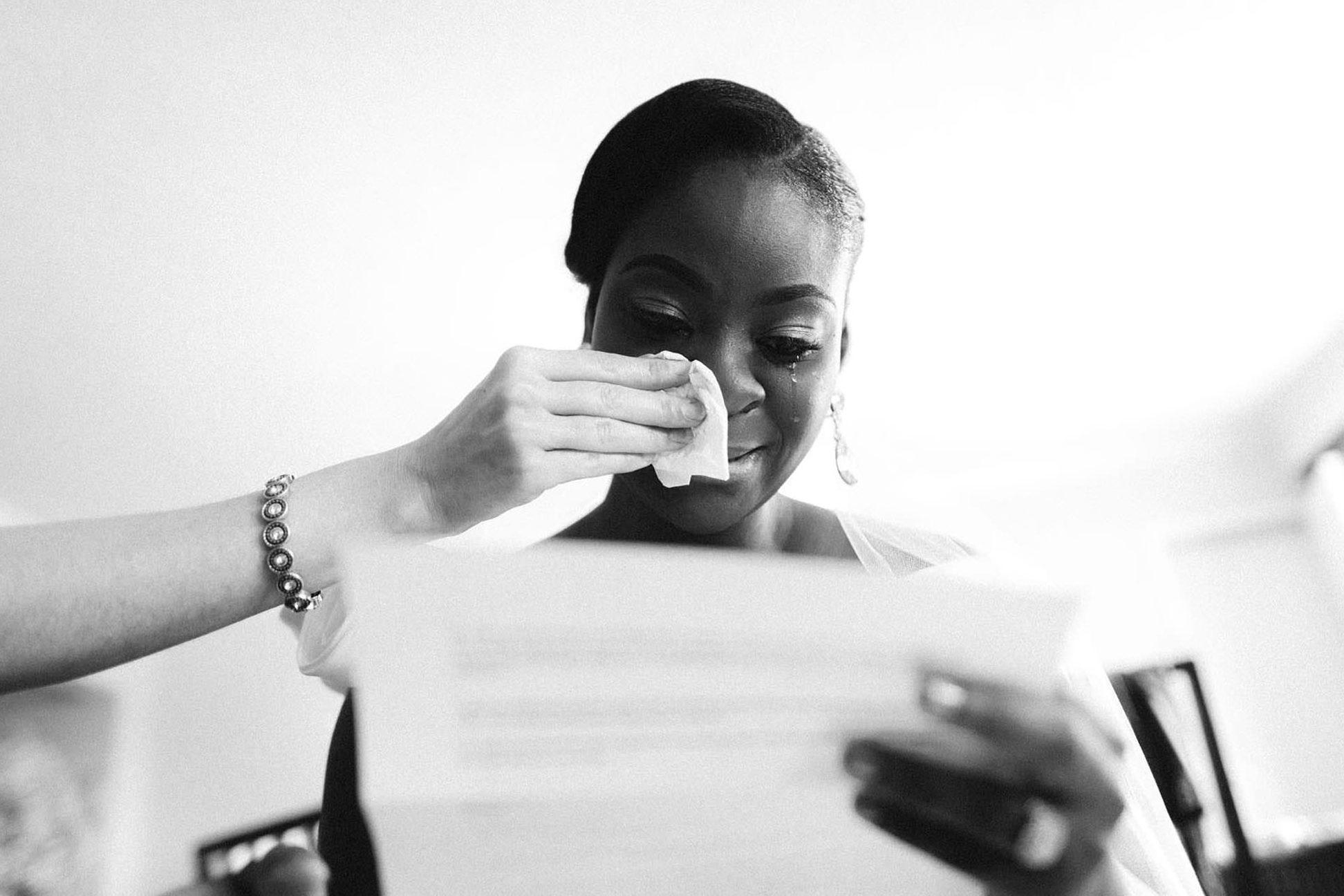 North Carolina wedding photographer capturing bride reading love letter